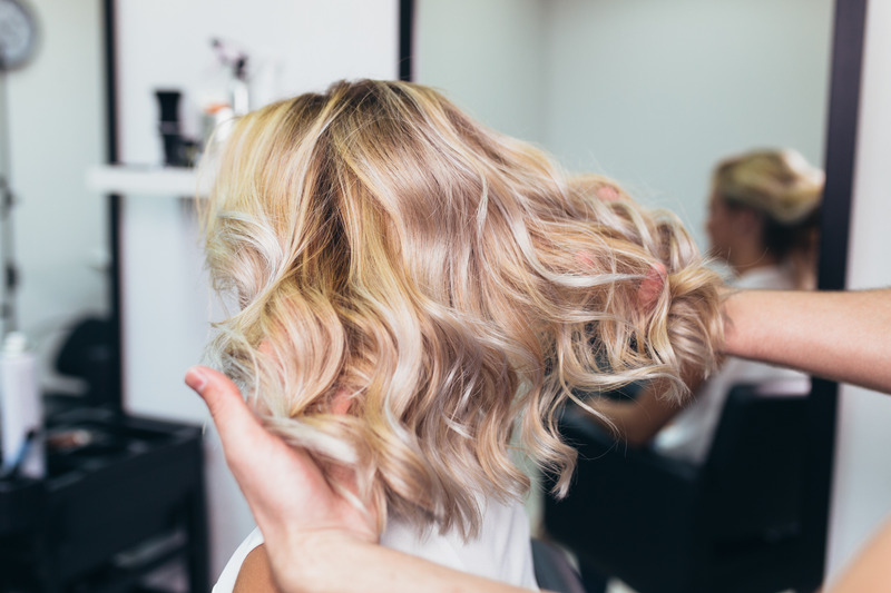 Curled blond hair with Hot Tools Professional