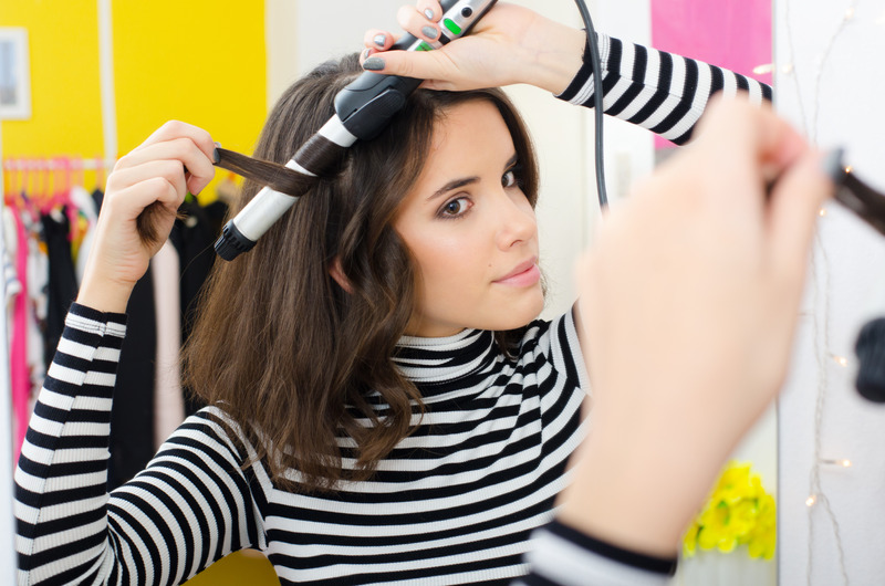 Curling hair with Braun curling iron