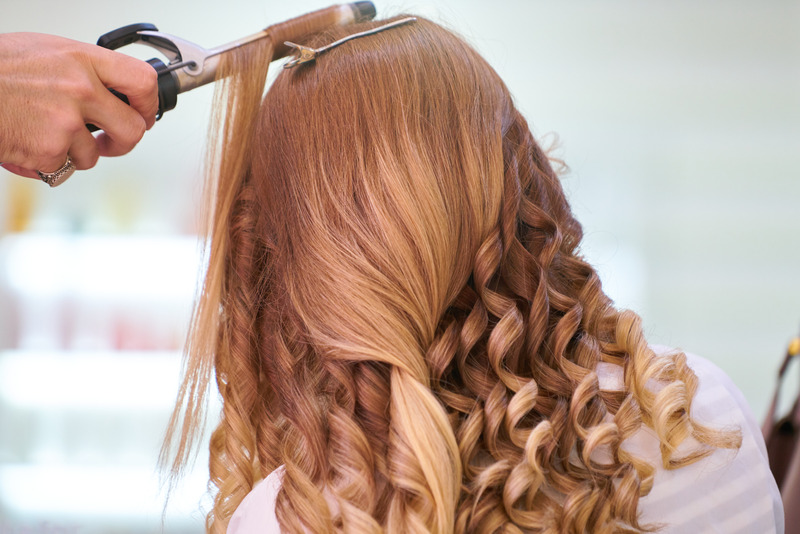 Curling thick hair with curling iron