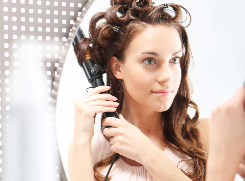 Curling hair with curling iron