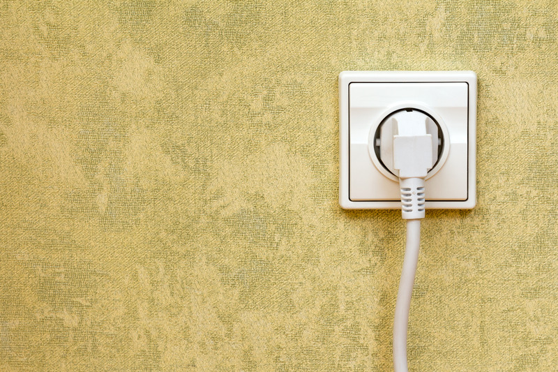 Electric Outlet with Cable Plugged